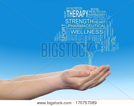 Concept conceptual black health text word cloud tagcloud as tree in man or woman hand  on blue sky background metaphor to health, nutrition, diet, wellness, body, energy, medical, sport, heart science