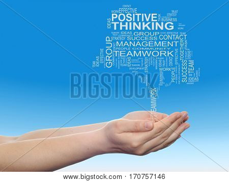 Concept conceptual business text word cloud on man hand, tagcloud on blue sky background metaphor to business, team, teamwork, management, effective, success, communication, company cooperation symbol