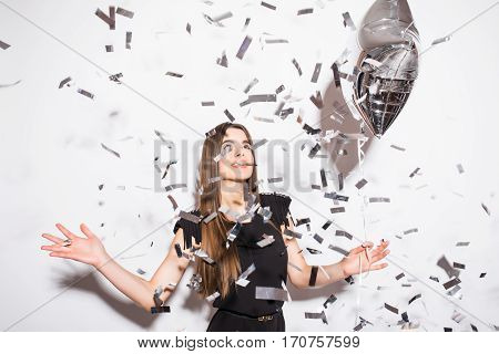 Beauty woman holding star balloon with fly confetti over white background