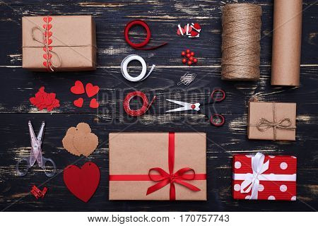 High angle of handcraft materials for preparation of gift boxes and cards. Rope, scissors, paper clip, ribbon and wrapping paper