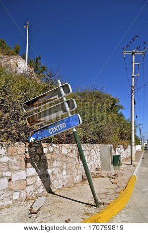 The Mazatlan centro bus system sign is in a state of disrepair in a pos district of the city.