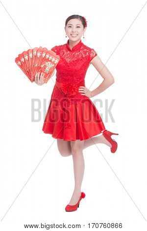 young asian woman in red cheongsam holds red envelope in chinese new year.words on them means to celebrate everybody good luck in coming year.