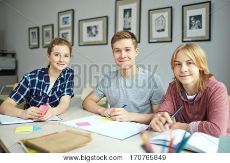 Team of youthful learners sitting in classroom