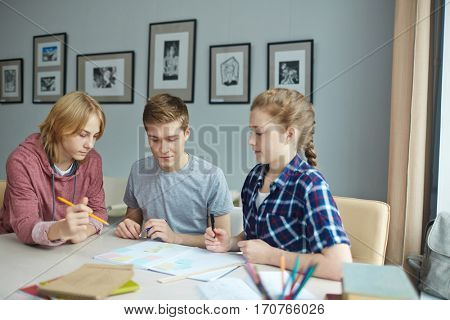 Three learners deciding what to do at lesson or discussing homework
