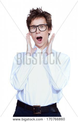 Excited young man in big glasses expresses fear and shock. Emotions. Isolated over white.