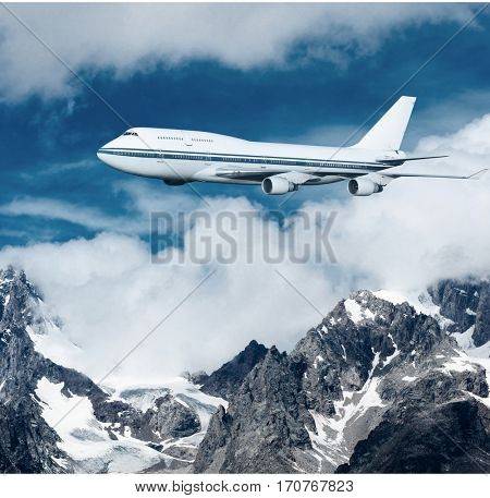 plane flying over the snow-capped mountains. passenger airplane in the clouds. travel by air transport. flying to the top of the airliner. nobody