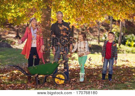 Happy family enjoying at park during autumn