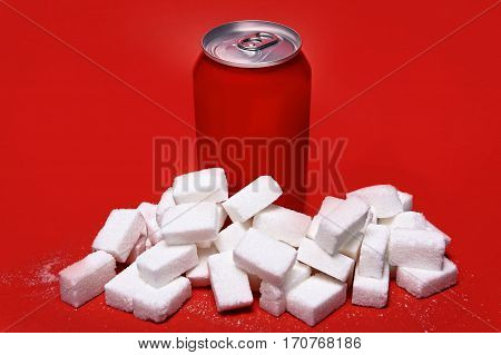 cola refreshing drink can and lot of white sugar cubes representing the big amount of calories content in the soda in unhealthy nutrition concept isolated on red background