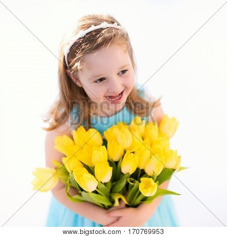 Little Girl With Tulip Flower Bouquet