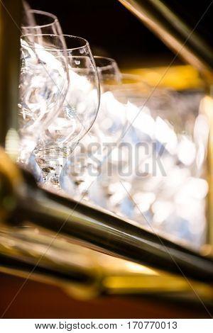 Close-Up of beer glasses arranged on bar shelf in restaurant