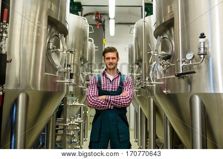 Portrait of brewer with arms crossed at brewery