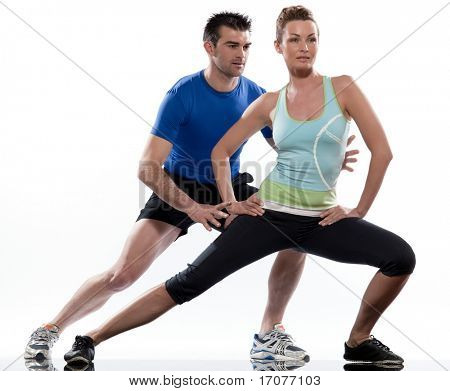 stretching workout posture by a couple, a man and a woman on studio white background