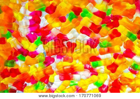 Jujube in sugar absence bone shape colorful abstract texture background back light closeup