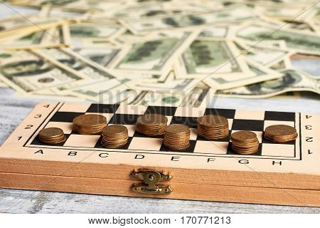 Stack of coins. Intellectual financial game. Checkers with coins.