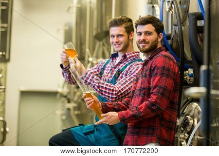 Portrait of brewers testing beer at brewery factory