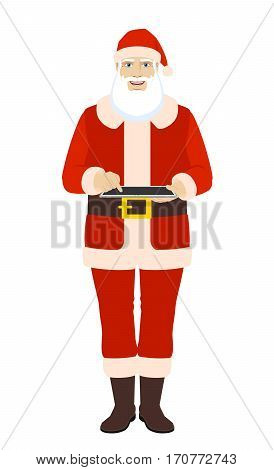 Santa Claus uses a digital tablet PC. Full length portrait of Santa Claus in a flat style. Vector illustration.