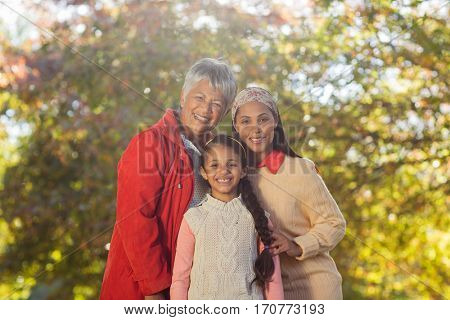 Portrait of happy multi-generation family at park