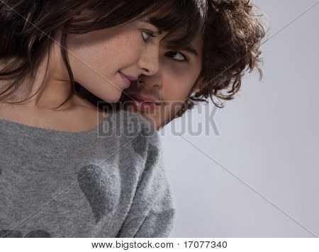 beuatiful caucasian young couple wearing a sweater with hearts on it