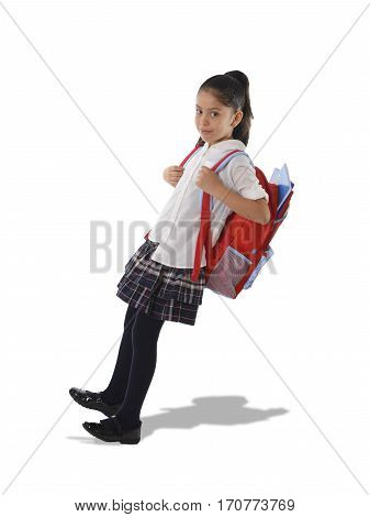 sweet little girl carrying very heavy and big backpack or huge schoolbag full of school books causing her leaning and falling on her back due to overweight isolated on white background