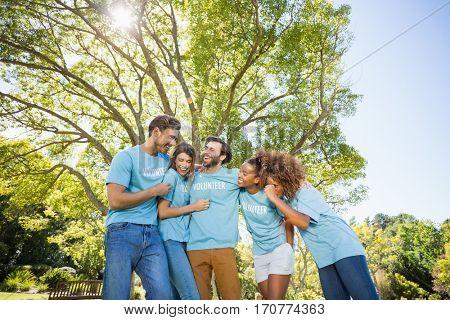 Group of volunteer having fun in park