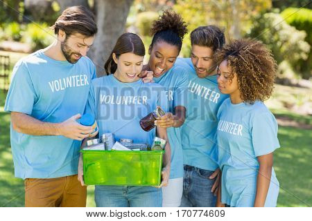 Group of volunteer holding box in park