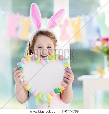 Little Girl In Bunny Ears On Easter Egg Hunt