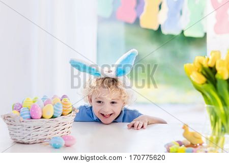 Child With Bunny Ears On Easter Egg Hunt