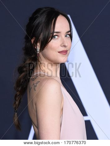 LOS ANGELES - FEB 02:  Dakota Johnson arrives to the