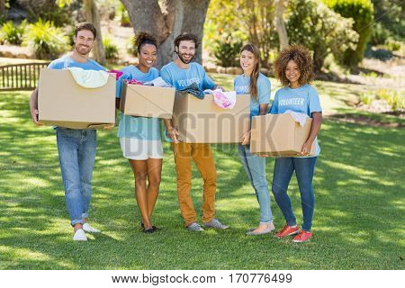 Group of volunteer holding cartons in park