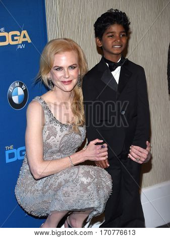 LOS ANGELES - FEB 04:  Nicole Kidman and Sunny Pawar in the press room at the 69th Annual DGA Awards on February 4, 2017 in Beverly Hills, CA