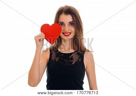 cutie young brunette woman with red lips and heart in hands smiling on camera isolated on white