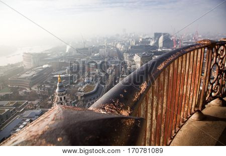 the grey city - aerial London view on a foggy day from St Paul's, UK