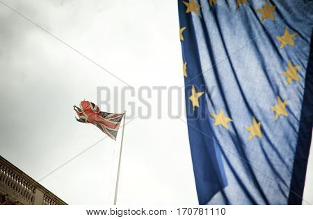 flags of UK and EU in the wind