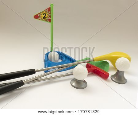 Background About Teaching The Game Of Golf With Toy Golf Clubs And Golf Balls, Holes And Flags