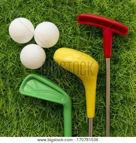 Golf set whit balls toy on green grass