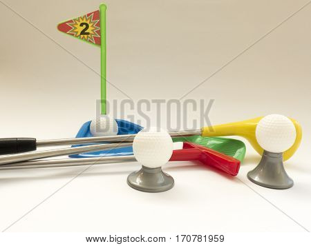 Three Golf Clubs - Wood, Putter, Iron And  Balls