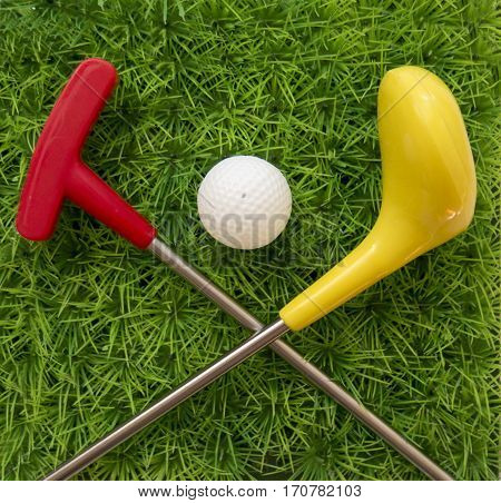 Toy Golf Club With Ball On The Grass