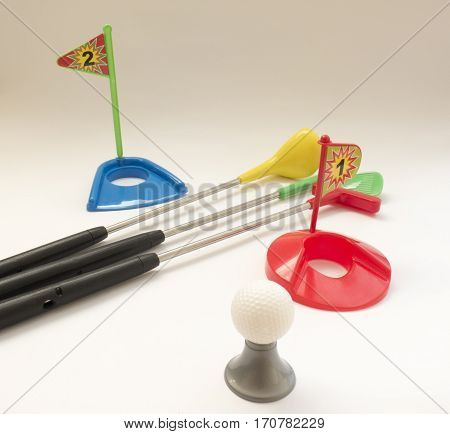 Toy Golf Set With Multi-colored Sticks, Balls, Flags