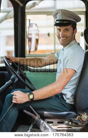 Portrait of smiling bus driver driving a bus