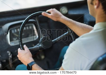 Mid-section of bus driver driving a bus