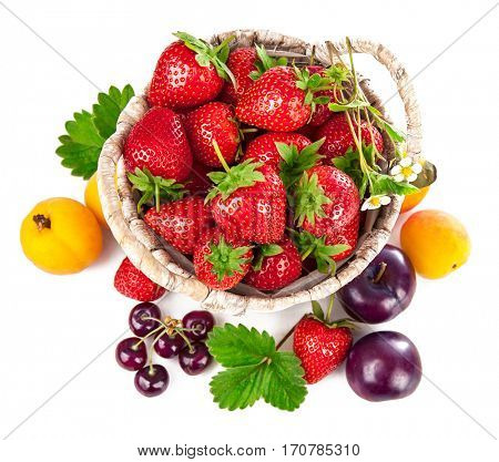 Berries healthy eating fruits harvest strawberries wicker basket still life. Isolated on white background top view.