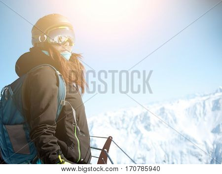 Girl on top of mountain