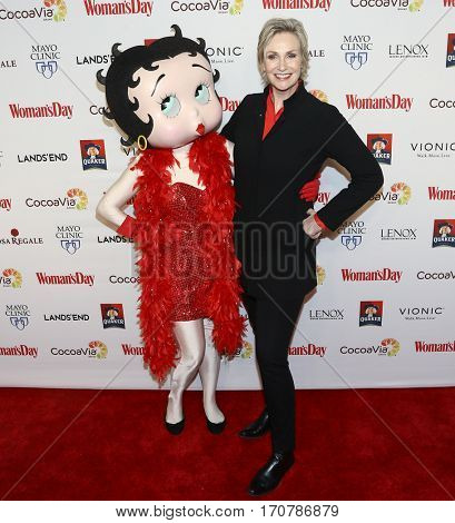 Actress Jane Lynch (R) and Betty Boop attend the 14th Annual Woman's Day Red Dress Awards at Jazz at Lincoln Center on February 7, 2017 in New York City.