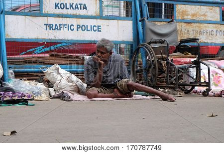 KOLKATA, INDIA - FEBRUARY 11: Beggars in front of Nirmal, Hriday, Home for the Sick and Dying Destitutes, established by the Mother Teresa and run by the Missionaries of Charity on February 11, 2016.