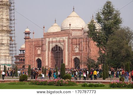 AGRA, INDIA - FEBRUARY 14 : Gate to the Taj Mahal (Crown of Palaces), an ivory-white marble mausoleum on the south bank of the Yamuna river in Agra, Uttar Pradesh, India on February, 14, 2016.