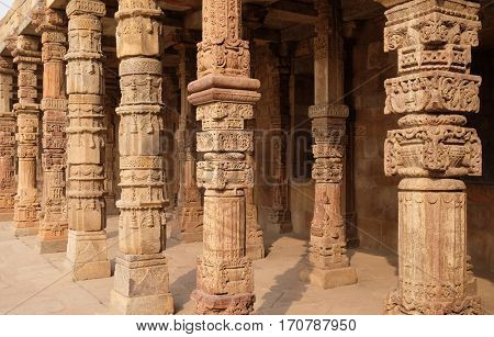 DELHI, INDIA - FEBRUARY 13 : Columns with stone carving in courtyard of Quwwat-Ul-Islam mosque, Qutab Minar complex, Delhi, India on February 13, 2016.