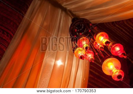 Traditional Arab lamps inside an Arabic tent