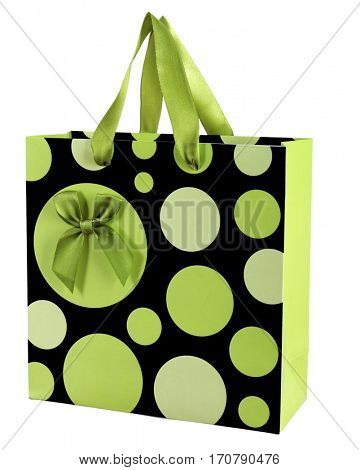Decorative paper gift bag with bow, on white background