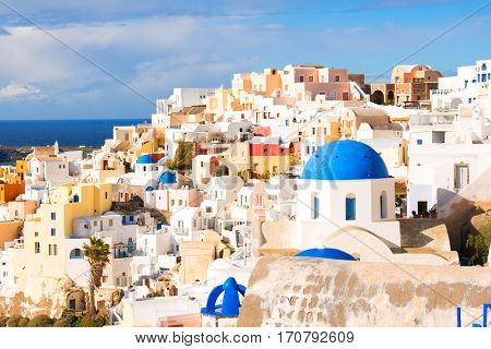 View of the seaside on a summer day.   Panorama of Oia village with colorful houses  , view of Oia town, Santorini island, Greece