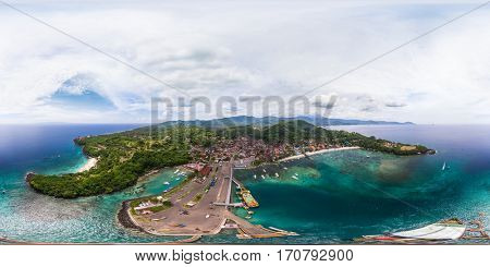 Spherical, 360 degrees, seamless aerial panorama of the tropical lagoon and marine port in the town of Padang Bai, Bali, Indonesia